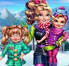 Mãe e filhas esquiar